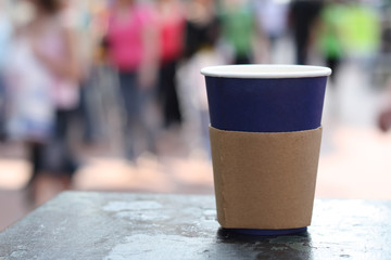 blue opened coffee cap on a street background
