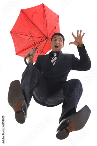Young, screaming businessman with umbrella