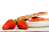 Strawberry jam toast - focus on strawberries in foreground poster
