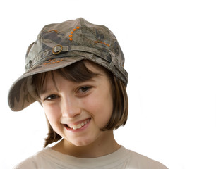 Smiling girl in a cap with copy space