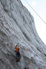 a man-climber rises on the icy wall