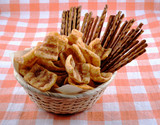 Basket to beer with chips and salty grain sticks poster