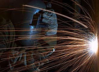 a welder working at shipyard at night