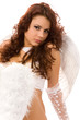 pretty woman dressed as angel on white background