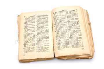 The open old book - the dictionary on a white background