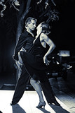 Couple dancing hot latin dance on a street at night poster