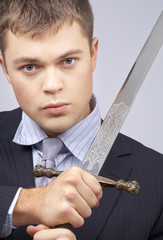 portrait of aggressive corporate worker with sword