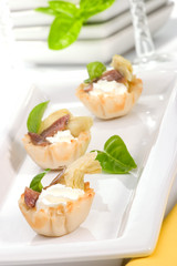 fillo shells filled with cream cheese, marinated artichoke