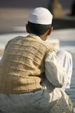 Muslim boy at Jama Masjid, Delhi, India poster