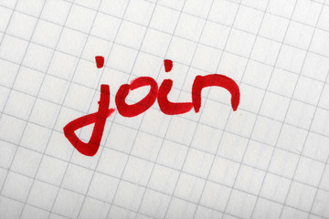 word JOIN on paper with thick red pen. Hand writing font