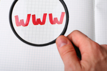 WWW under magnifying glass. Searching internet concept