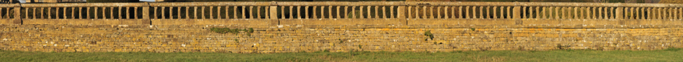 A long panoramic picture of an old wall,