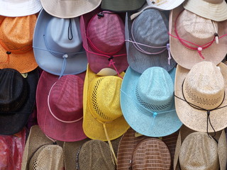 Multi-coloured hats for sale at local market in Mexico