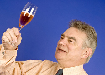 Man Holding a Glass of Pink Champagne