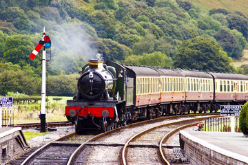 A steam train approaching the station
