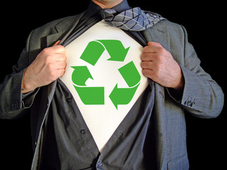 A business man opens his shirt to reveal a recycle sign