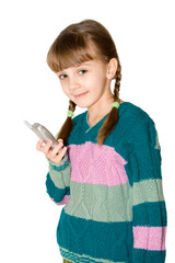 The girl in a color sweater holds mobile phone in a hand