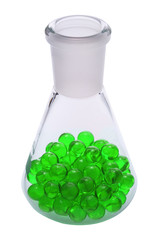 Green pills in a conical flask, isolated on white.