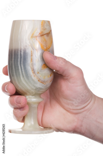 hand holds an stone goblet. Isolated with clipping path