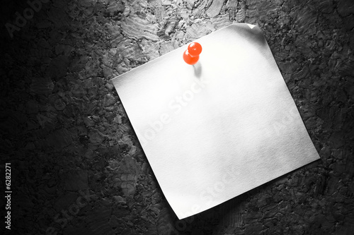 Office paper pinned on a cork board with a red pin.  - 6282271