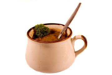 Mug of Soup with Spoon and Garnish