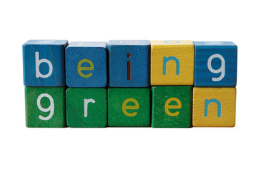 the phrase 'being green' in isolated on white