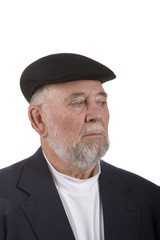 An older scottish gentleman wearing a black hat and looking down