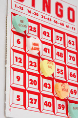Candy hearts being used as chips in a game of Bingo