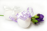 Two white eggs and freesia isolated on white
