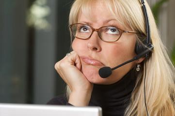 Bored Businesswoman on Telephone Headset