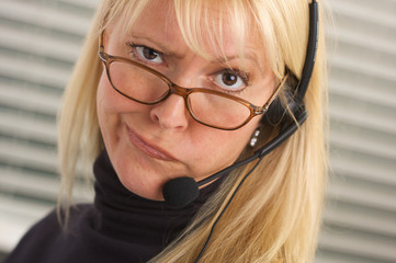 Exasperated Attractive Businesswoman with Phone Headset