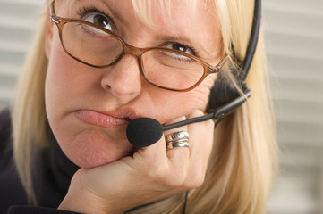 Attractive Bored Businesswoman with Phone Headset