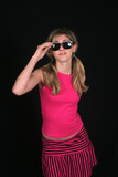 Fashion blond in sunglasses and red top