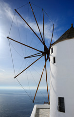 Windmill on the island of Santorini, overlooking the Aegean Sea