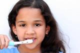 Fototapety Young girl is brushing her teeth in bathroom
