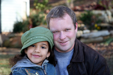 Father with Daughter outside with jackets in winter