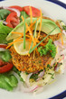 Carrot And tuna patties on a herbed potato stack with salad.