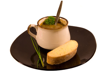 Chicken and Vegetable Soup with Bread and Garnish on Black Plate