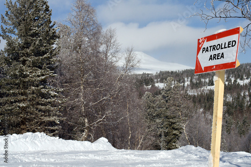 Sign patrolled area on mountain slope for ski and snowboarding