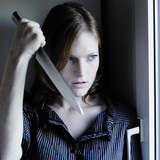 Evil woman with knife poster