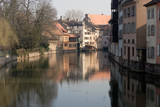 Warm glow of the slowely setting sun on a Strasbourg canal. poster