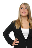 Teen girl wearing formal attire looking up poster