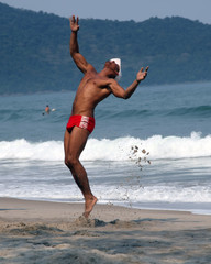 men doing capoeira on the beach