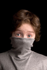 Boy in Turtleneck over a black background