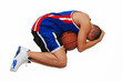 joueur de basket en position de foetus