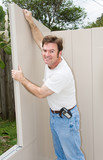 Handyman or home owner putting up a wall  poster