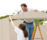 Father and daughter working on a home improvement project poster