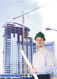 Young Architect standing in front of highrise poster