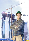 Construction worker standing in front of a new highrise poster