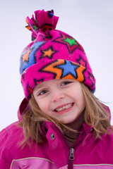 Little Girl playing outside in the snow